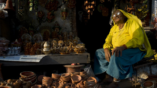 An Indian woman sells earthenware oil pots or &quot;diyas&quot; at a roadside stall in the run up to last year's Diwali Festival. Diyas are in heavy demand during the festival as they are used to hold lit oil lamps and decorate the interior and exterior of homes.