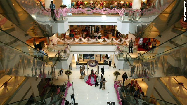 Customers are seen browsing the boutique and commercial department stores inside the &quot;Shoppers Stop&quot; mall. Since it opened in 2007, the mall is said to be the largest in the country, spanning an area of 135,000 square feet and providing an overwhelming range of premium international and national brands.