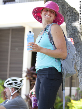 Fit Nation athletic director April Burkey rocks a pink hat while waiting for the &quot;Lucky 7&quot; to get fitted for rental bikes in Hawaii.
