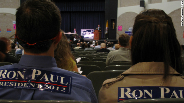 Two Ron Paul supporters sit in the back of Virginia's 8th Congressional District convention Saturday, waiting to vote for delegates to the national convention.