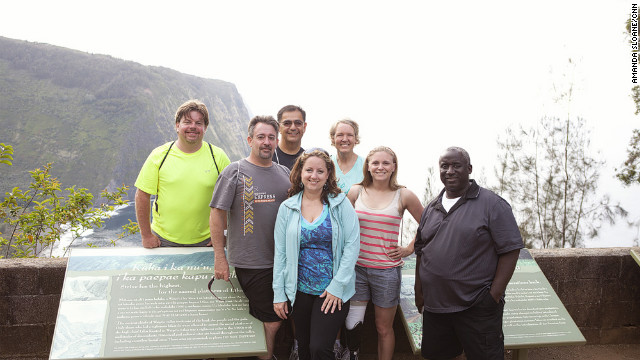"The Fit Nation ""Lucky 7"" arrives in Kailua-Kona, Hawaii, on Sunday, May 13, for a week of training. The group will be participating in the Nautica Malibu Triathlon with CNN's Dr. Sanjay Gupta in September. Here they take a group picture before hiking down the Waipio Valley Trail."