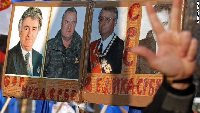 Serb nationalists protest against the U.S. and the U.N. war crimes court in Belgrade in December 2006. Their posters show pictures of Karadzic, Mladic and Vojislav Seselj with the Cyrillic writing meaning: &quot;God saves the Serbs&quot; and &quot;Great Serbia.&quot;