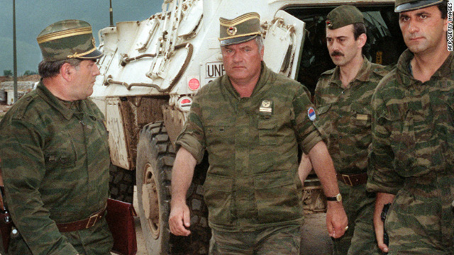 General Ratko Mladic, center, commander of Serbian forces in Bosnia, arrives at Sarajevo airport on August 10, 1993 to negotiate the withdrawal of his troops from Mount Igman.
