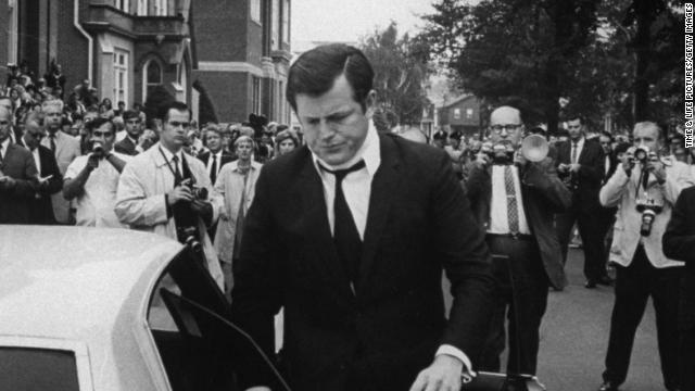 Sen. Ted Kennedy drove a car off a bridge on Massachusetts' Chappaquiddick Island after a party in 1969. Aide Mary Jo Kopechne died in the accident. He is shown wearing a neck brace at her funeral. Controversy over the incident effectively ended his presidential aspirations.