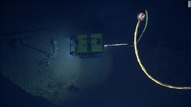 NOAA's Seirios Camera Platform, operating above the Little Hercules ROV, images the shipwreck and its remnants, including its anchor.
