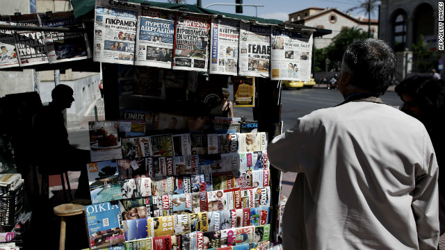 A man reads a newspaper in central Athens on May 17, 2012. Debt-laden Greece is headed for new elections next month following an indecisive vote on May 6, amid growing fears over the country's eurozone future.