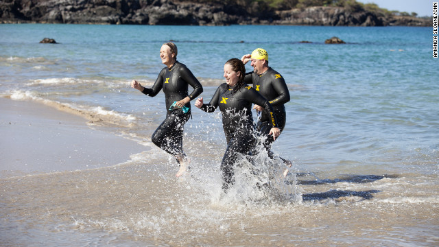 Klinger, LaGier and Morris emerge from the ocean after a long practice swim.