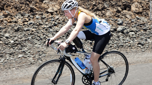 Castelli, a below-the-knee amputee, rides her bike through the lava fields.