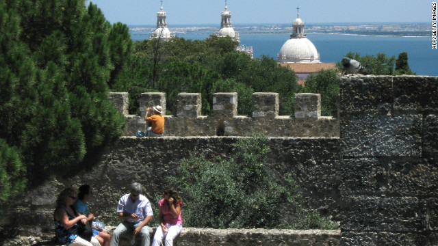 Tourists visit Sao Jorge Castle in Lisbon, Portugal in July 2008.