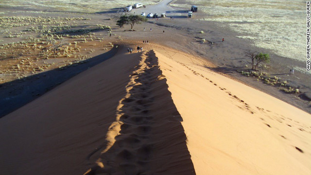 Climbers can either walk or slide down the dunes to get back to the bottom.