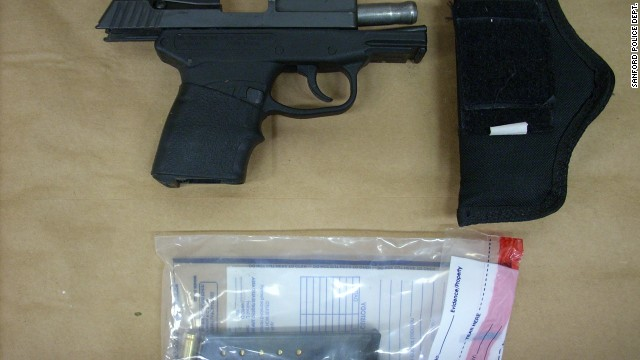 "Zimmerman's gun is displayed. The shooting raised questions about gun laws, as well as the merit of the ""stand your ground"" law in Florida and similar laws in other states."