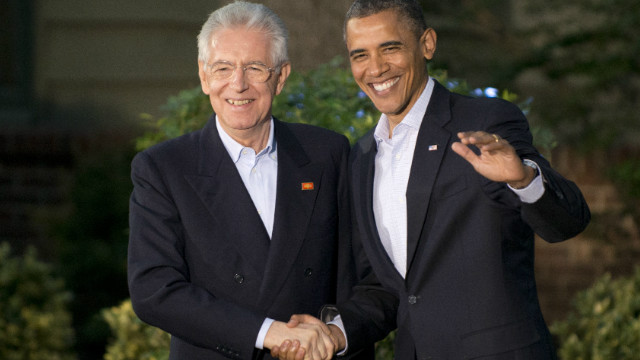President Barack Obama greets Italian Prime Minister Mario Monti upon his arrival at Camp David in Maryland on Friday.