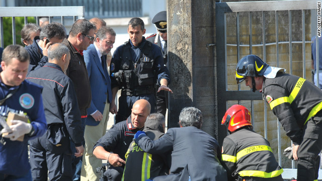 Police and rescuers work after a blast near a school in Brindisi, Italy.