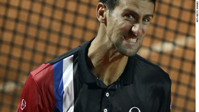 Novak Djokovic celebrates his semifinal win over Roger Federer in the Rome Masters.