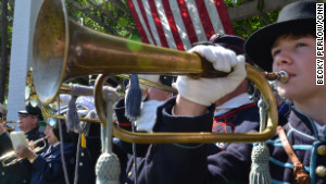Buglers and trumpeters from around the United States gathered at Arlington National Cemetary in Washington D.C. on Saturday to commeorate the 150th anniversary of \
