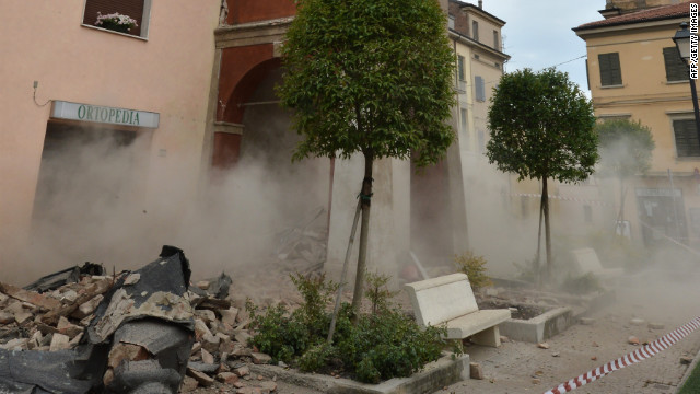 Smoke rises from a building in San Felice sul Panaro.