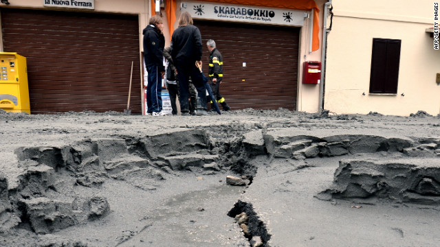 The central street of San Carlo village is damaged following the powerful earthquake.