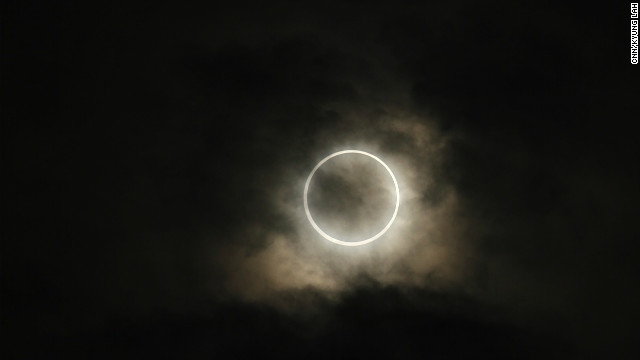 A rare solar eclipse is seen from Tokyo on Monday morning. People across the globe planned viewing parties to watch the event.