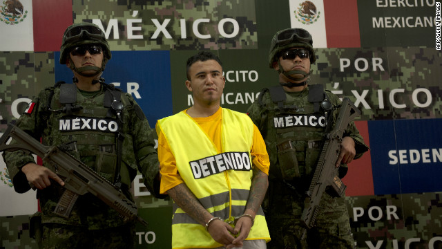 Mexican soldiers escort suspect Daniel de Jesus Elizondo Ramirez, known as