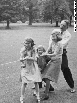 Rhodes playing in a tug of war with Princess Elizabeth and her sister, Princess Margaret.