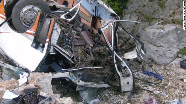Albanian authorities say a bus carrying university students fell off a cliff Monday, killing at least 12 people.