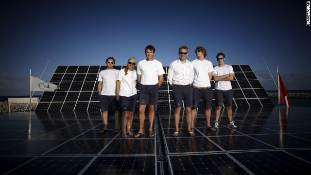 "Skipper Raphael Domjan (third from the right) with his crew aboard the ""Turanor,"" which is dotted with 536 square-meters of photovoltaic panels - enough to cover over two tennis courts."