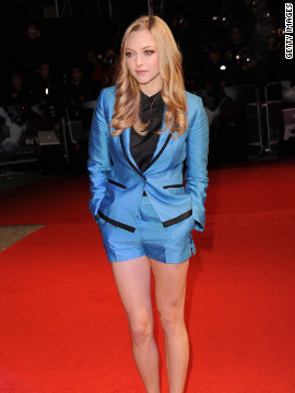 "Amanda Seyfried attends the UK premiere for the film ""In Time"" wearing a blue tuxedo-style blazer and shorts from H&M's new sustainable fashion collection -- Exclusive Conscious."