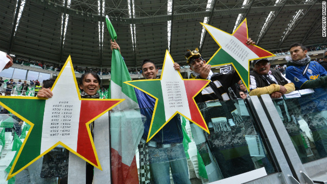 Juventus fans hold up three stars to signify the 30 championships won by the club, but two in 2005 and 2006 have been struck off the official records after the &quot;Calciopoli&quot; match-fixing scandal.