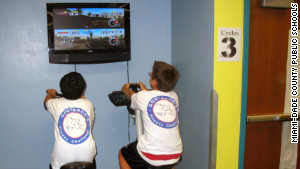 Students at an elementary school in Miami, Flordia, compete in an exer-game on stationary bikes.