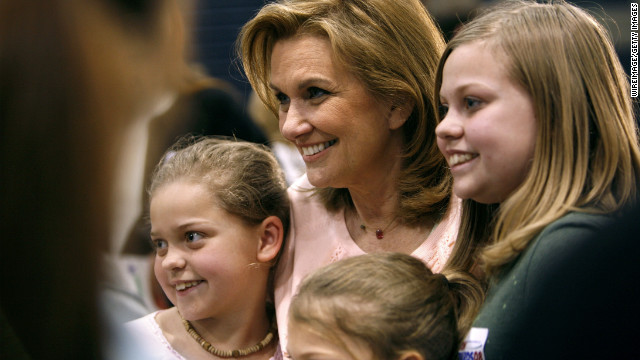 Edwards' wife, Elizabeth, meets with children after a town-hall gathering in Iowa in 2007. She passed away in 2010 from breast cancer after separating from Edwards.