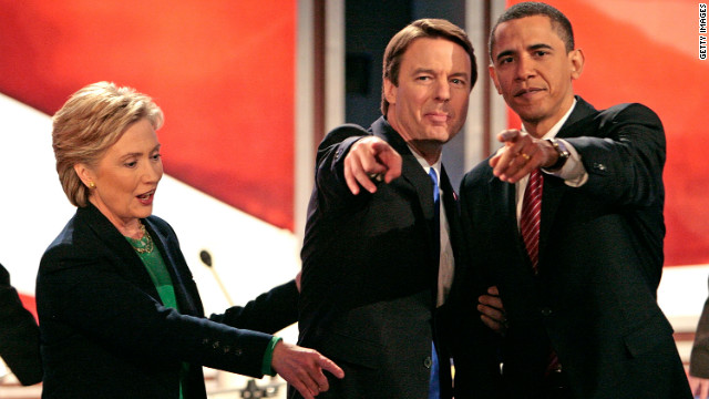 Presidential hopefuls Hillary Clinton, Edwards and Barack Obama point to supporters and family members in the audience after a debate in New Hampshire in January 2008.