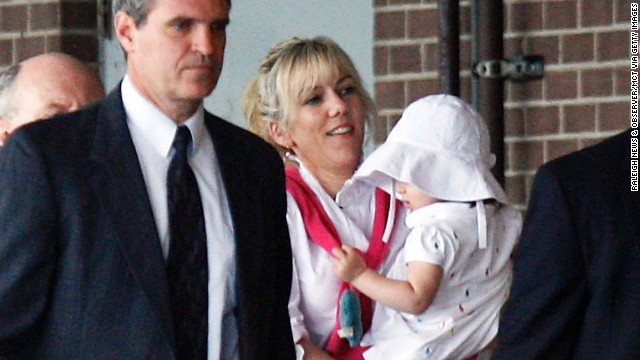 Rielle Hunter, Edwards' former mistress, holds their daughter, Frances Quinn Hunter, in August 2009. Prosecutors accused Edwards of using nearly $1 million in illegal campaign contributions to keep his pregnant mistress under wraps as he ran for president in 2008. Defense attorneys argued the donations could not be considered campaign contributions. They said Edwards was guilty of being a bad husband but had committed no crime.