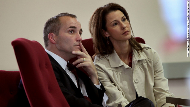 Former Edwards aide Andrew Young and his wife, Cheri, listen during a 2010 hearing in North Carolina. Defense attorneys argued that Young used the money for his own gain and to pay for Hunter's medical expenses to hide the affair from Edwards' wife.