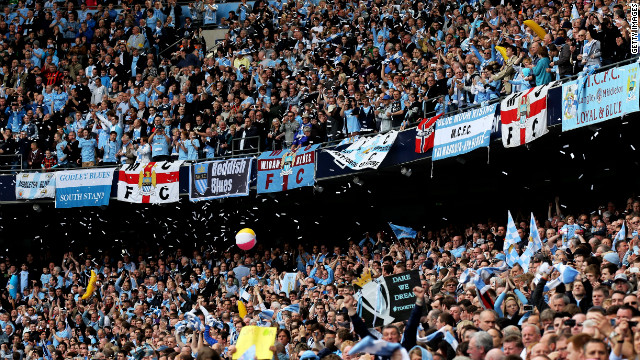 Manchester City fans saw their team clinch a first English top division title in 44 years.