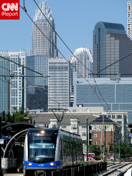 "Charlotte's light rail system zips commuters around the city. ""There's a light rail line near my house, so I can get uptown without driving,"" says Tim Hass, who shot this photo."