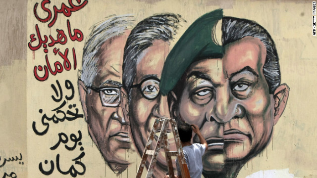 Cairo graffiti pictures, from right, Hosni Mubarak, military ruler Hussein Tantawi and candidates Amre Mussa and Ahmed Shafiq.