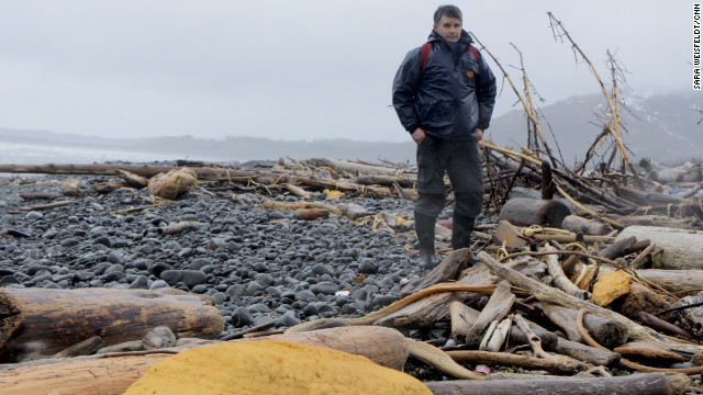 Chris Pallister braves the elements on Montague Island to survey debris for the Marine Conservation Alliance. He said the yellow urethane spray building foam insulation, which came from stockyards and from crushed structures in Japan, started showing up in January. &quot;We just never got much of that before, but if you walk up and down this beach you see big chunks,&quot; he said. 