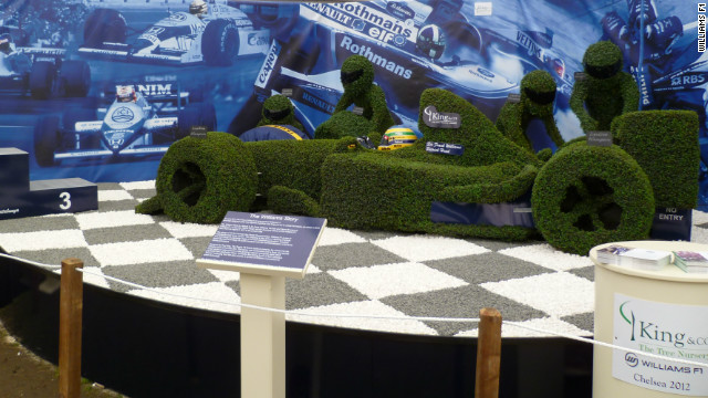 The display at London's Chelsea Flower Show was awarded the prestigious gold medal. The topiary features a life-size F1 car and pit crew.