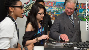 TORONTO, ON - MAY 22: Prince Charles, Prince of Wales puts on headphones as he learns how to scratch and fade with a turntable as he visits an employment skills workshop at Yonge Street Mission and UforChange on day 2 of an official Diamond Jubilee Tour of Canada on May 22, 2012 in Toronto, Canada. (Photo by Anwar Hussein/WireImage)