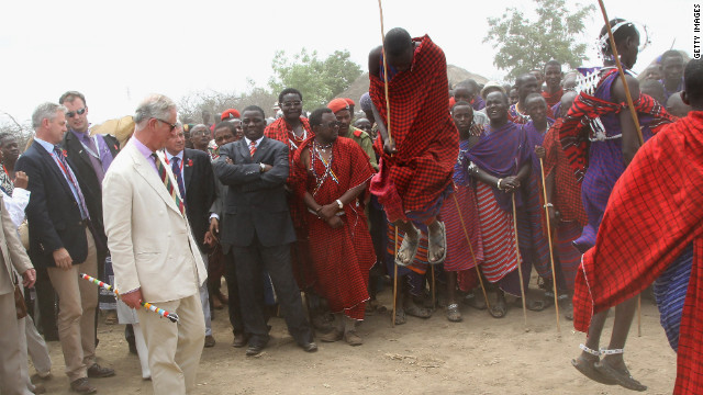 The Prince of Wales watches Maasai dancing during a visit to a Majengo Maasai village near Arusha, Tanzania, on November 9, 2011.