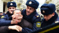 Police officers manhandle a political activist during a protest in Baku, Azerbaijan, 12 March 2011.