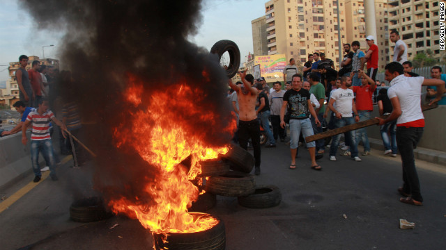Shiite Muslim youths set tires on fire to block a road at the entrance of Beirut's southern suburbs on Tuesday.