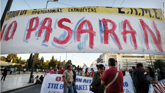 Anti-austerity protesters gather behind a banner in central Athens on May 22 but many want Greece to keep the euro.