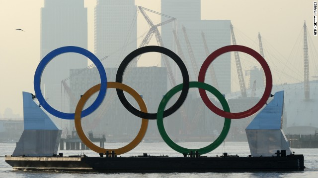 Olympic rings float on a barge in front of the skyscrapers of Canary Wharf -- one of London's financial centers.