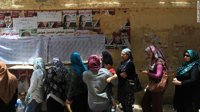 Egyptian women wait in line Thursday to cast their vote outside a<br /> 1000<br />  polling station in Cairo. If no candidate gets a majority of the vote in the first round of voting, a second round will be held June 16-17.