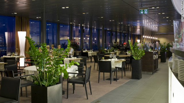 Large glass windows allow diners to enjoy lobster risotto and beef tartar while watching planes take off.