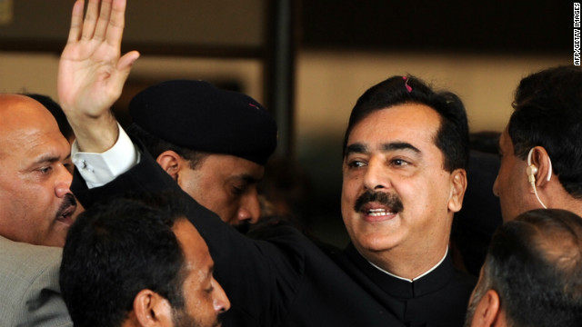 Pakistani Prime Minister Yousuf Raza Gilani, center, arrives with security at the Supreme Court building in Islamabad in April.