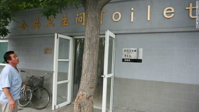 A man in Beijing checks out one of the toilets newly constructed before the Olympic Games in this July 5, 2008, picture.