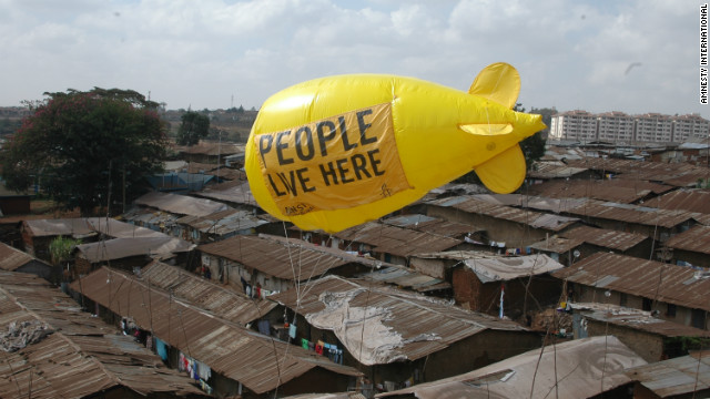 Residents and activists in an informal settlement facing forced eviction in Nairobi, Kenya walk a huge balloon down a railway line in March 2012 during a week of action against forced evictions.