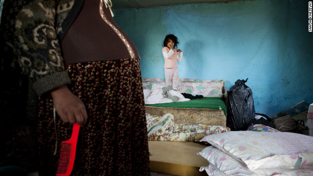 A pregnat mother and her daughter at home before the forced eviction of an informal Roma settlement in Belgrade. The Belgrade city authorities, on behalf of the government of Serbia, authorised the eviction to make way for commercial housing on the government-owned land.